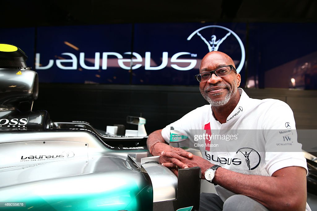 Laureus Sport for Good Foundation Chairman Edwin Moses poses with the car belonging to Nico Rosberg of Germany and Mercedes GP during a Laureus photocall ahead of the Chinese F1 Grand Prix at Shanghai International Circuit on April 11, 2015 in Shanghai, China.