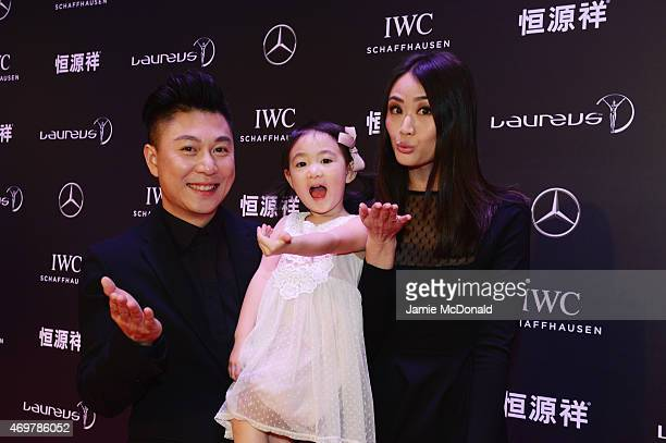 Laureus World Sports Academy member Li Xiaopeng with wife Angel and daughter Olivia attend the 2015 Laureus World Sports Awards at Shanghai Grand...