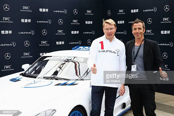 Laureus World Sports Academy member Mika Hakkinen with Thomas Gassmann during a Mercedes Red Carpet photocall at the Shanghai Grand Theatre prior to...