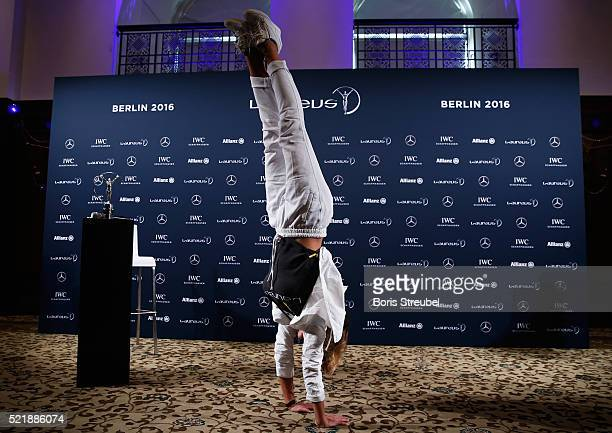 Laureus World Sports Academy member Nadia Comaneci performs a handstand at the press conference to celebrate 40 Years After The Perfect 10 on April...
