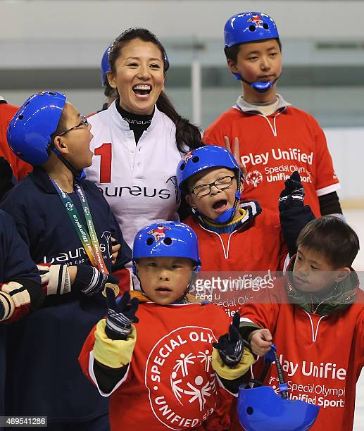 Laureus World Sports Academy member Yang Yang of China visits a Laureus Sport For Good Project prior to the Laureus World Sports Awards 2015 at the...