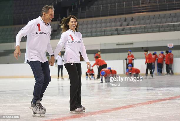Laureus World Sports Academy members Franz Klammer and Nadia Comaneci visit a Laureus Sport For Good Project prior to the Laureus World Sports Awards...