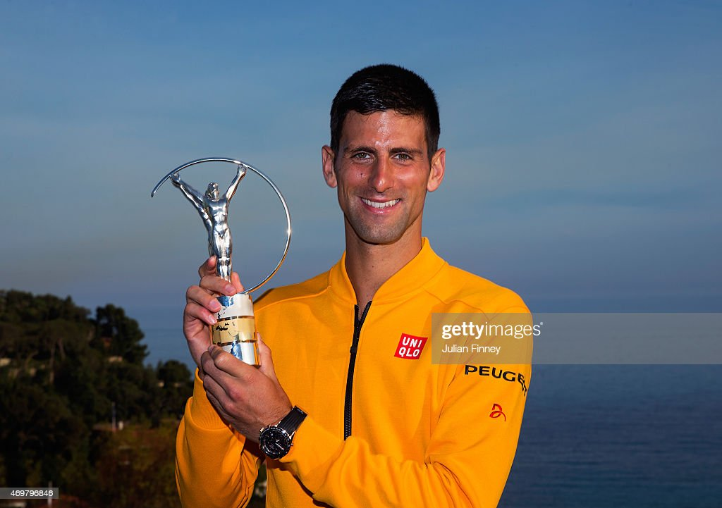 Laureus World Sportsman of the Year 2015 winner and Tennis player <a gi-track='captionPersonalityLinkClicked' href=/galleries/search?phrase=Novak+Djokovic&family=editorial&specificpeople=588315 ng-click='$event.stopPropagation()'>Novak Djokovic</a> of Serbia poses with his award at the Monte-Carlo Sporting Club on April 14, 2015 in Monte-Carlo, Monaco.
