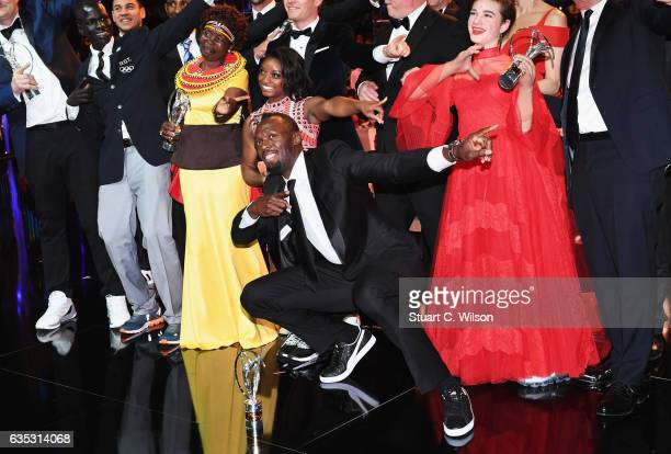 Laureus World Sportsman of the Year Award winner Usain Bolt poses with the other Laureus World Sports Awards winners pose for a selfie on stage...