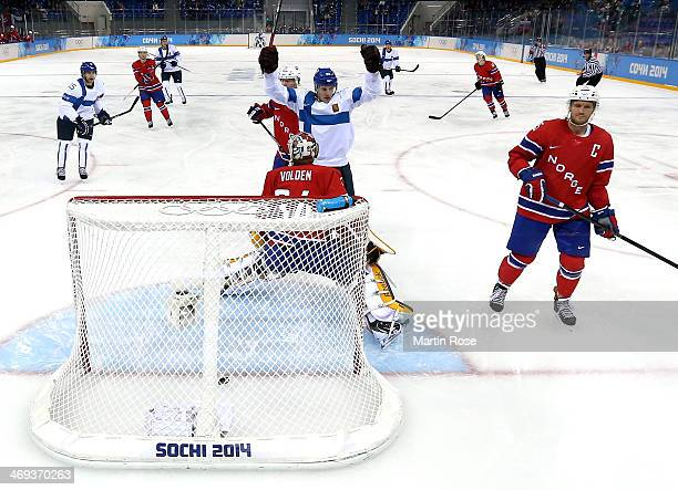 Lauri Korpikoski of Finland celebrates after scoring in the second period against Lars Haugen of Norway during the Men's Ice Hockey Preliminary Round...