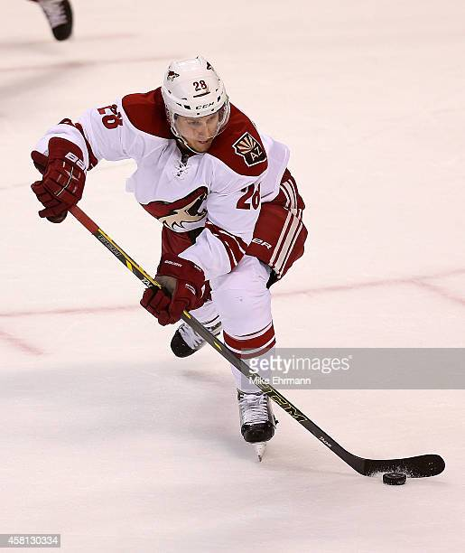 Lauri Korpikoski of the Arizona Coyotes looks to pass during a game against the Florida Panthers at BBT Center on October 30 2014 in Sunrise Florida