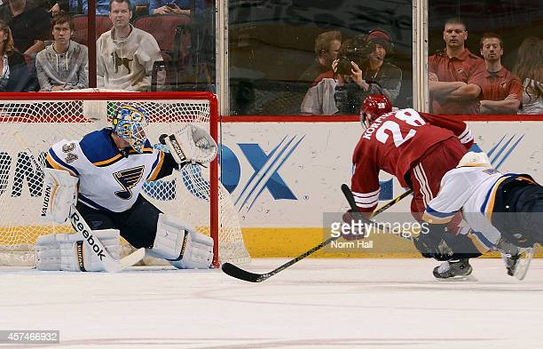 Lauri Korpikoski of the Arizona Coyotes shoots the puck past goaltender Jake Allen of the St Louis Blues for a goal during the third period at Gila...