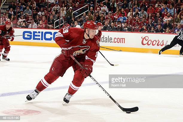Lauri Korpikoski of the Arizona Coyotes skates up ice with the puck against the Ottawa Senators at Gila River Arena on January 10 2015 in Glendale...