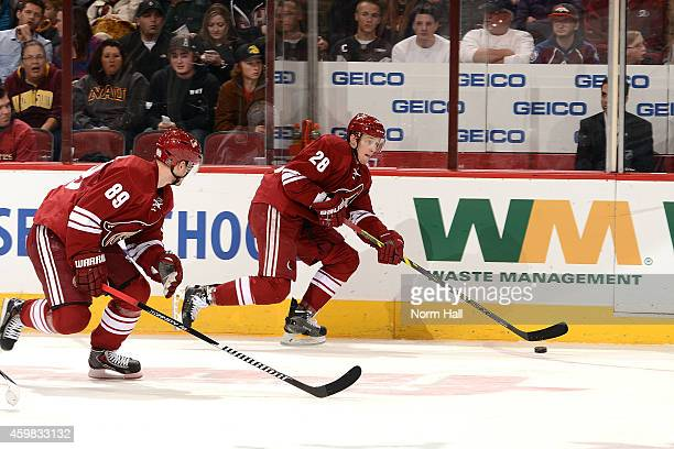 Lauri Korpikoski of the Arizona Coyotes skates with the puck against the Colorado Avalanche at Gila River Arena on November 25 2014 in Glendale...