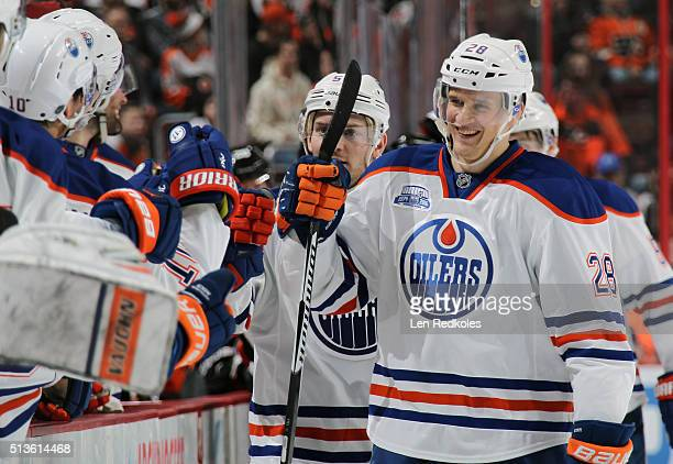 Lauri Korpikoski of the Edmonton Oilers celebrates his third period shorthanded goal against the Philadelphia Flyers with his teammtes on the bench...