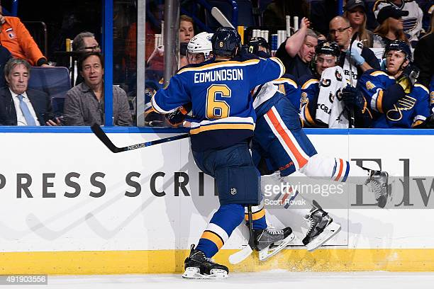 Lauri Korpikoski of the Edmonton Oilers is checked by Joel Edmundson of the St Louis Blues on October 8 2015 at Scottrade Center in St Louis Missouri