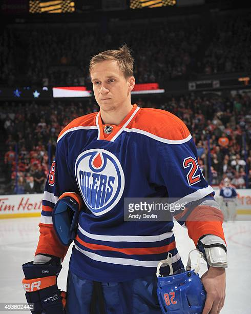 Lauri Korpikoski of the Edmonton Oilers stands for the singing of the national anthem prior to a game against the Detroit Red Wings on October 21...