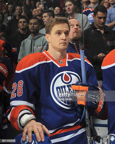 Lauri Korpikoski of the Edmonton Oilers stands for the singing of the national anthem prior to a game against the Boston Bruins on December 2 2015 at...