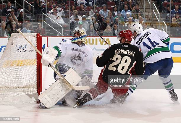 Lauri Korpikoski of the Phoenix Coyotes scores a second period goal past goaltender Roberto Luongo of the Vancouver Canucks during the NHL game at...