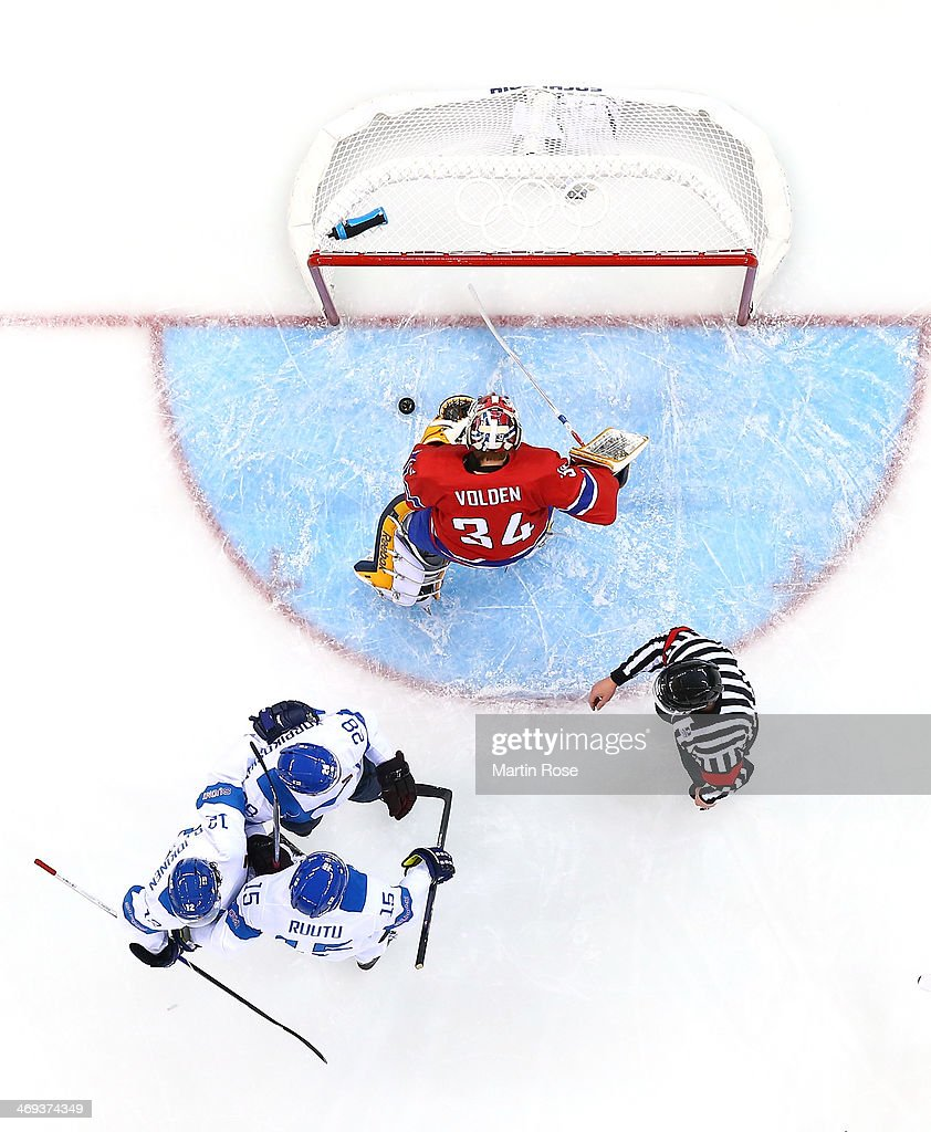 Lauri Korpikoski #28, Tuomo Ruutu #15 and Olli Jokinen #12 of Finland celebrate after a goal by Korpikoski in the second period against Lars Volden #34 of Norway during the Men's Ice Hockey Preliminary Round Group B game on day seven of the Sochi 2014 Winter Olympics at Shayba Arena on February 14, 2014 in Sochi, Russia.