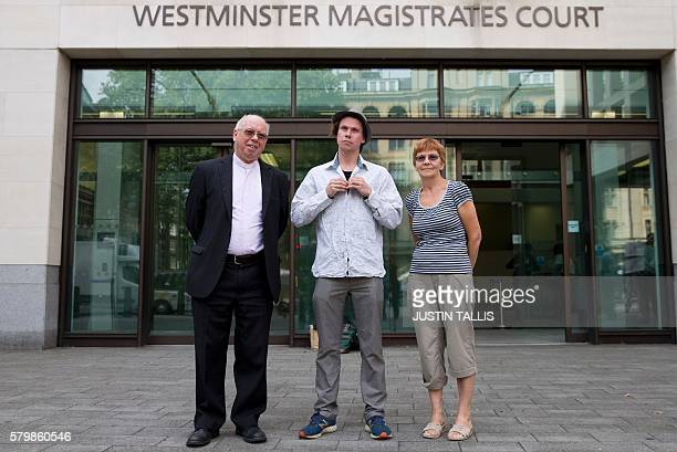 Lauri Love poses for photographers with his father Reverend Alexander Love and mother Sirkka as he arrives at Westminster Magistrates Court in...