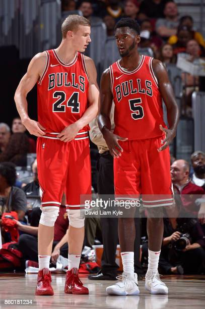 Lauri Markkanen and Bobby Portis of the Chicago Bulls talk during the game against the Cleveland Cavaliers on October 6 2017 at Quicken Loans Arena...