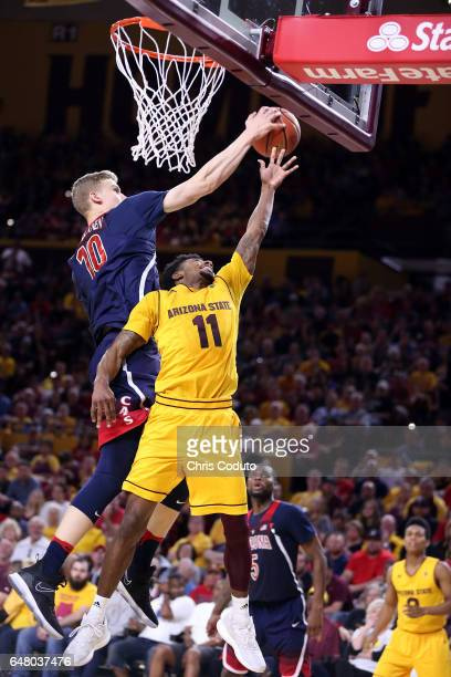 Lauri Markkanen of the Arizona Wildcats blocks a shot by Shannon Evans II of the Arizona State Sun Devils during the second half of the college...