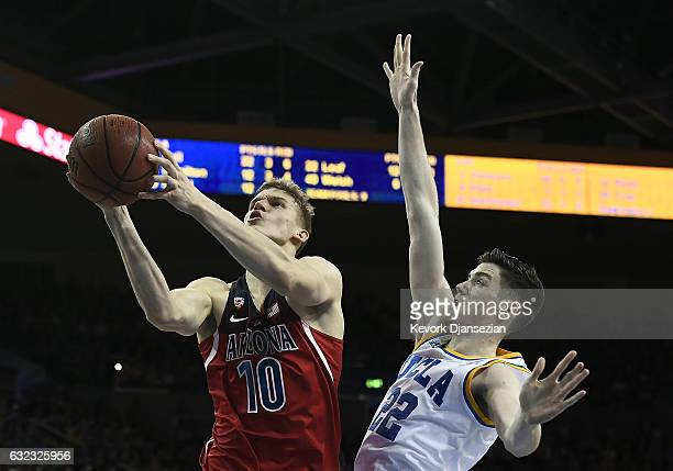 Lauri Markkanen of the Arizona Wildcats drives to the basket against TJ Leaf of the UCLA Bruins during the second half of the game at Pauley Pavilion...