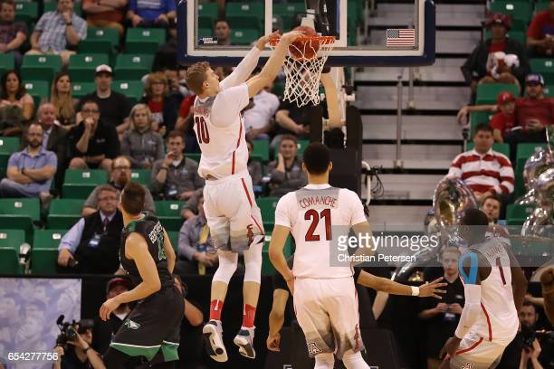 Lauri Markkanen of the Arizona Wildcats dunks the ball against the North Dakota Fighting Sioux during the first round of the 2017 NCAA Men's...