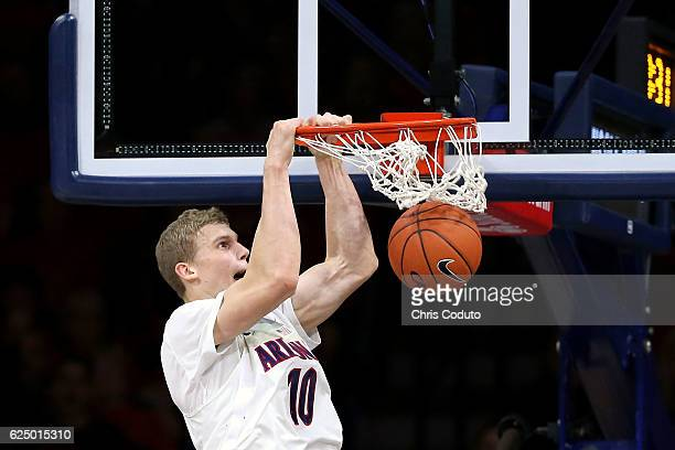 Lauri Markkanen of the Arizona Wildcats dunks the ball during the second half of the NCAA college basketball game against the Northern Colorado Bears...