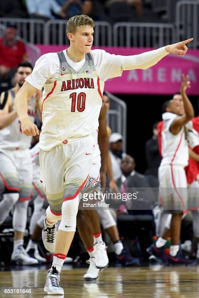 Lauri Markkanen of the Arizona Wildcats gestures after scoring against the Colorado Buffaloes during a quarterfinal game of the Pac12 Basketball...