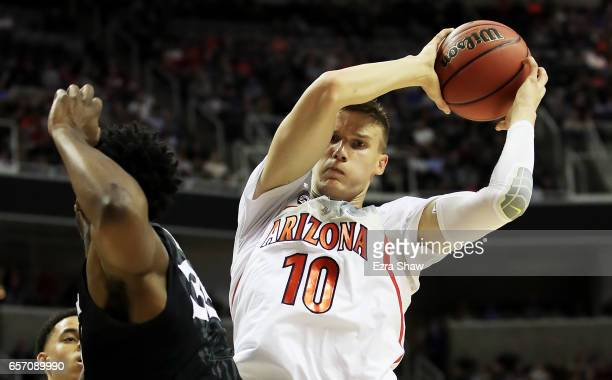 Lauri Markkanen of the Arizona Wildcats goes up against RaShid Gaston of the Xavier Musketeers in the first half during the 2017 NCAA Men's...