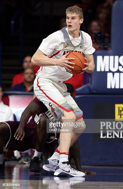 Lauri Markkanen of the Arizona Wildcats grabs a rebound during the first half of the NCAA college basketball game against the Texas Southern Tigers...