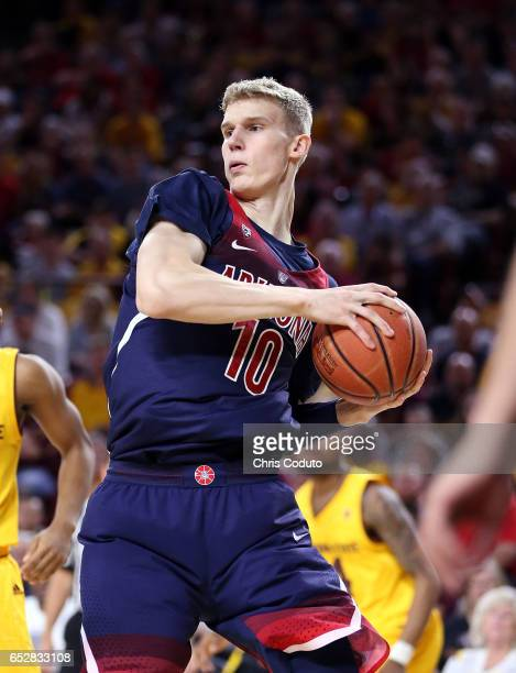 Lauri Markkanen of the Arizona Wildcats grabs a rebound during the second half of the college basketball game against the Arizona State Sun Devils at...