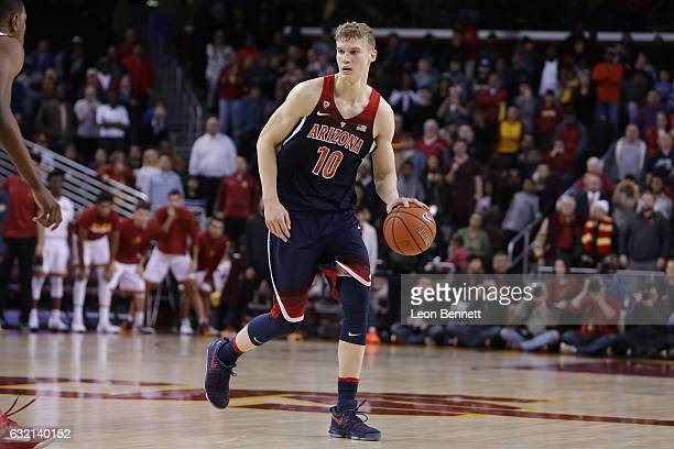 Lauri Markkanen of the Arizona Wildcats handles the ball against he USC Trojans during NCAA Pac12 conference college basketball game at Galen Center...