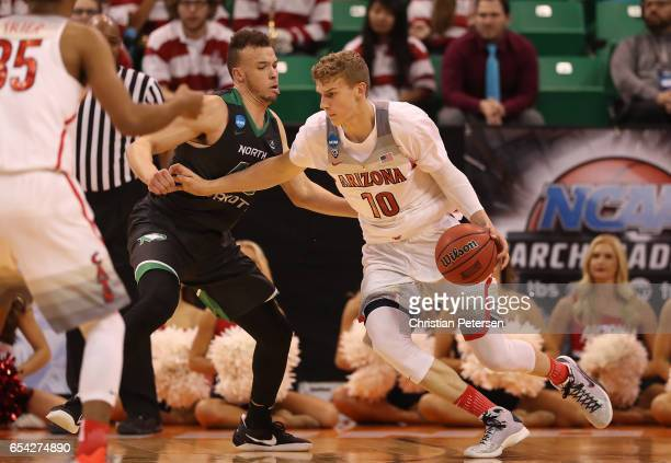 Lauri Markkanen of the Arizona Wildcats is defended by Drick Bernstine of the North Dakota Fighting Sioux during the first round of the 2017 NCAA...