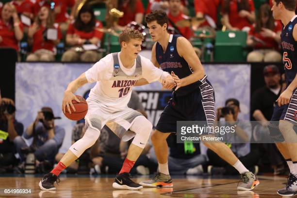 Lauri Markkanen of the Arizona Wildcats is defended by Evan Fitzner of the St Mary's Gaels during the second round of the 2017 NCAA Men's Basketball...