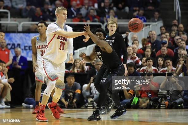 Lauri Markkanen of the Arizona Wildcats is defended by Quentin Goodin of the Xavier Musketeers during the 2017 NCAA Men's Basketball Tournament West...