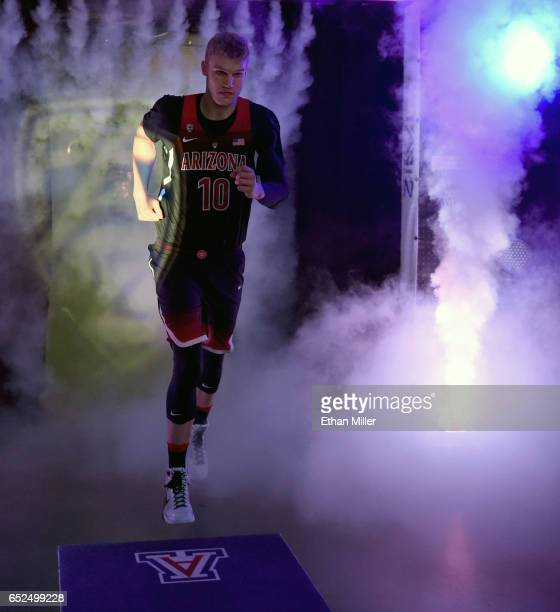 Lauri Markkanen of the Arizona Wildcats is introduced before the championship game of the Pac12 Basketball Tournament against the Oregon Ducks at...