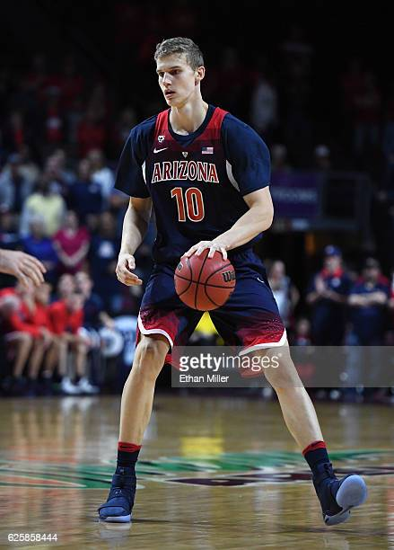 Lauri Markkanen of the Arizona Wildcats looks to pass against the Butler Bulldogs during the championship game of the 2016 Continental Tire Las Vegas...