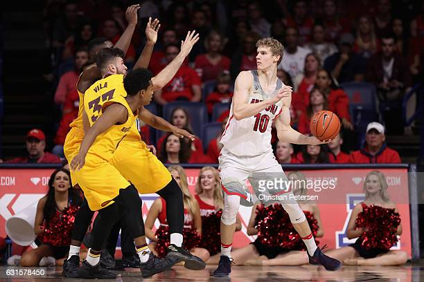 Lauri Markkanen of the Arizona Wildcats looks to pass during the second half of the college basketball game against the Arizona State Sun Devils at...