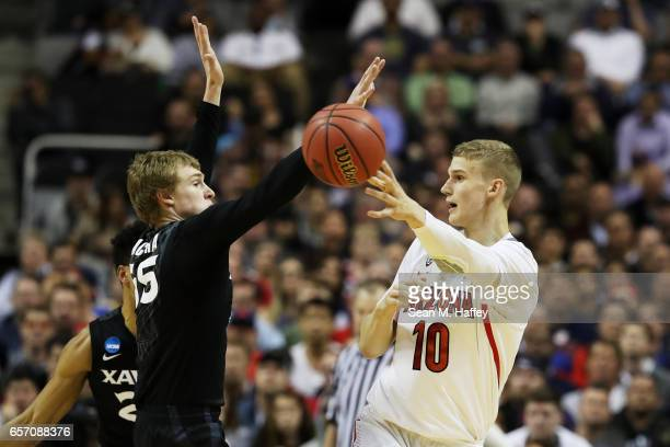Lauri Markkanen of the Arizona Wildcats passes against JP Macura of the Xavier Musketeers in the first half during the 2017 NCAA Men's Basketball...