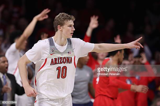 Lauri Markkanen of the Arizona Wildcats reacts after hitting a three point shot against the New Mexico Lobos during the second half of the college...