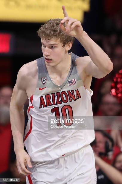 Lauri Markkanen of the Arizona Wildcats reacts after scoring against the Arizona State Sun Devils during the second half of the college basketball...