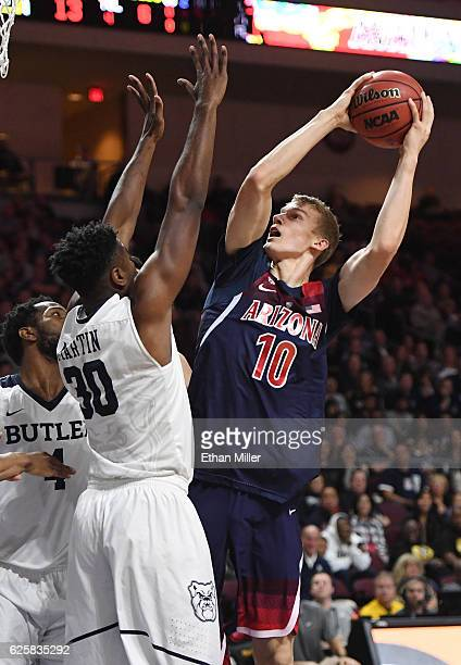 Lauri Markkanen of the Arizona Wildcats shoots against Kelan Martin of the Butler Bulldogs during the championship game of the 2016 Continental Tire...