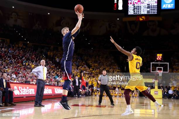 Lauri Markkanen of the Arizona Wildcats shoots over Tra Holder of the Arizona State Sun Devils during the first half of the college basketball game...