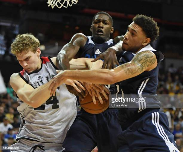Lauri Markkanen of the Chicago Bulls and Dorian FinneySmith and Brandon Ashley of the Dallas Mavericks fight for a rebound during the 2017 Summer...