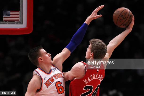 Lauri Markkanen of the Chicago Bulls attempts a shot while being guarded by Kristaps Porzingis of the New York Knicks in the first quarter at the...