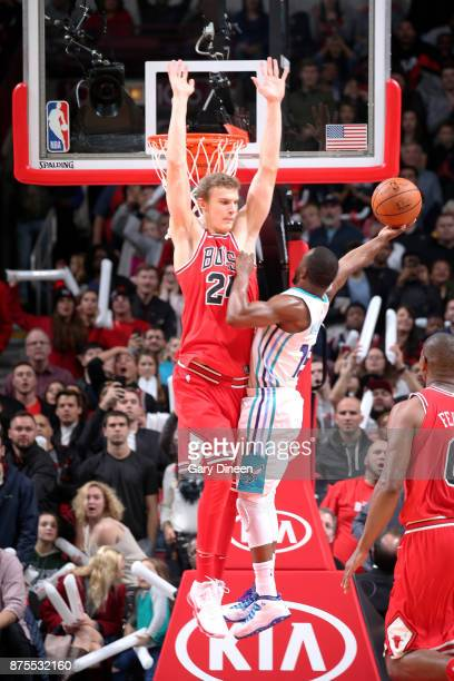 Lauri Markkanen of the Chicago Bulls contests the shot of Kemba Walker of the Charlotte Hornets on November 17 2017 at the United Center in Chicago...
