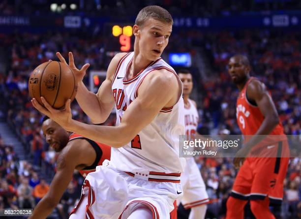 Lauri Markkanen of the Chicago Bulls dribbles the ball during the first half of an NBA game against the Toronto Raptors at Air Canada Centre on...