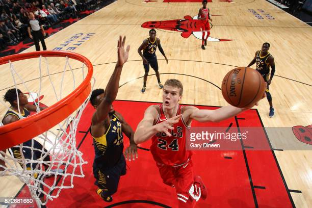 Lauri Markkanen of the Chicago Bulls drives to the basket against the Indiana Pacers on November 10 2017 at the United Center in Chicago Illinois...