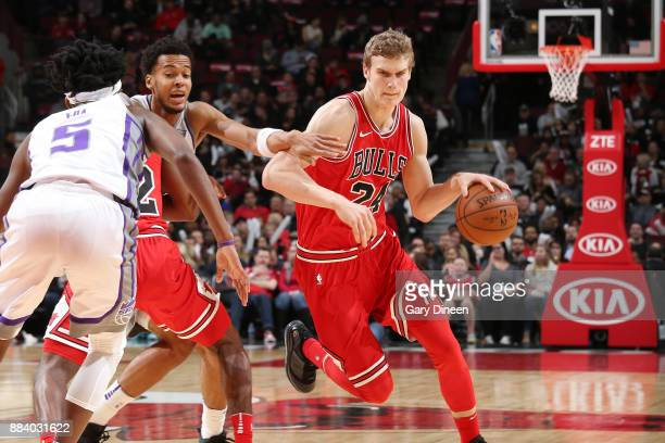 Lauri Markkanen of the Chicago Bulls drives to the basket against the Sacramento Kings on December 1 2017 at the United Center in Chicago Illinois...