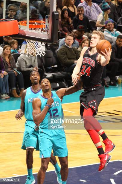 Lauri Markkanen of the Chicago Bulls goes to the basket against the Charlotte Hornets on December 8 2017 at Spectrum Center in Charlotte North...