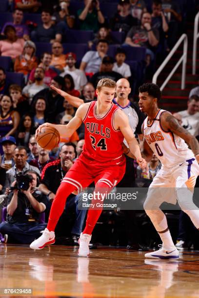 Lauri Markkanen of the Chicago Bulls handles the ball against Marquese Chriss of the Phoenix Suns on November 19 2017 at Talking Stick Resort Arena...
