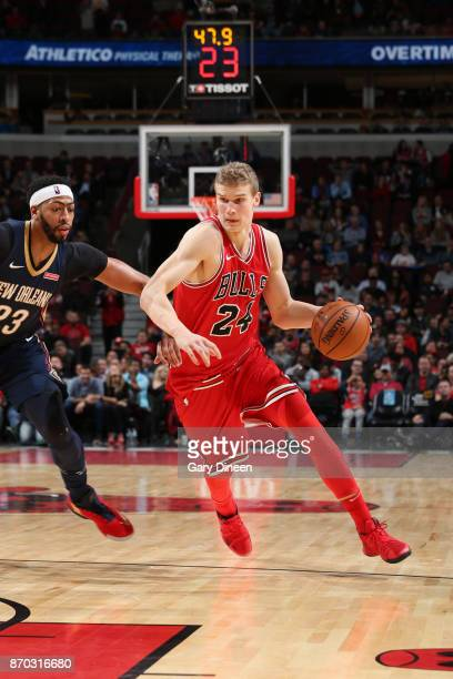 Lauri Markkanen of the Chicago Bulls handles the ball against the New Orleans Pelicans on November 4 2017 at the United Center in Chicago Illinois...